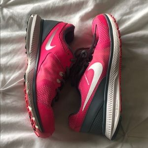 Bright pink nike workout shoes